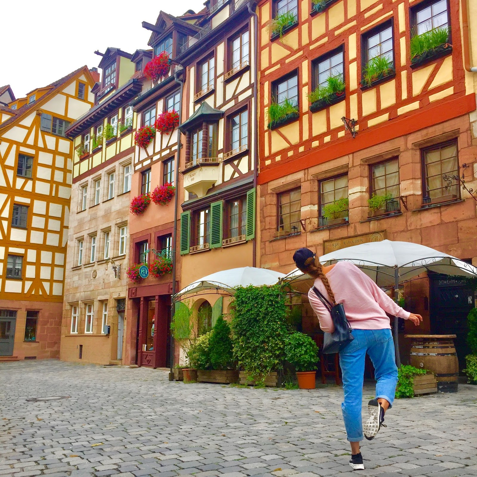 Pretty street in Nuremberg with colourful medieval architecture