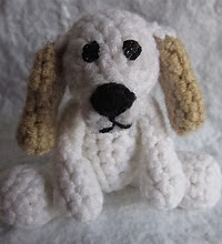 http://www.ravelry.com/patterns/library/prince-the-tiny-puppy