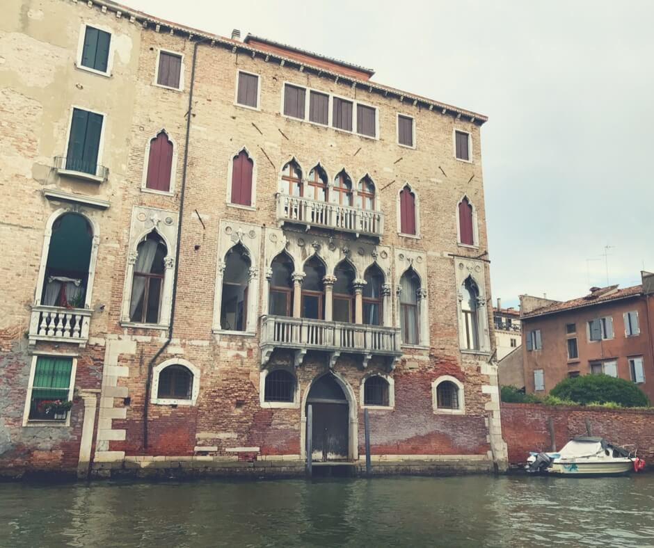 A venetian building, photo taken from the canal. Venice.