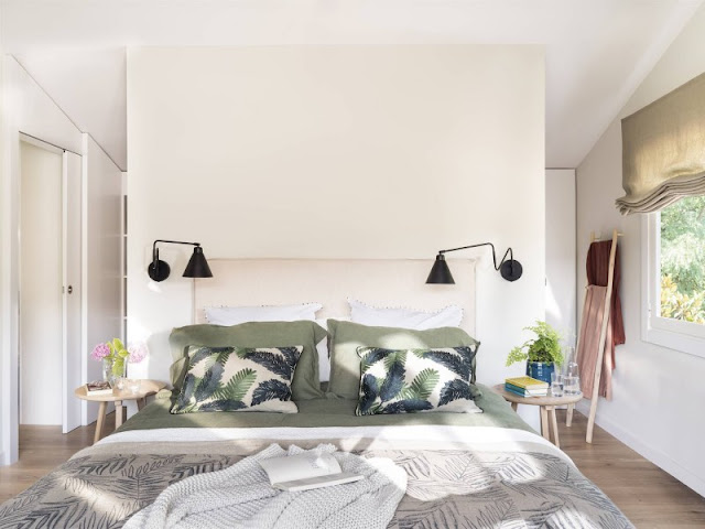 Casa contemporanea in stile Urban Jungle con palette di colori ispirata ai paesaggi naturali