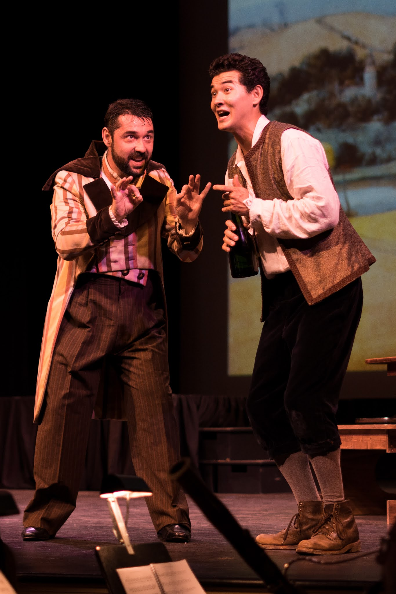 IN REVIEW: bass-baritone YURI KISSIN as Dulcamara (left) and tenor PAVEL SULIANDZIGA as Nemorino (right) in the Emerald Cast of Opera in Williamsburg's September 2021 production of Gaetano Donizetti's L'ELISIR D'AMORE [Photograph © by Diego Valdez; used with permission]