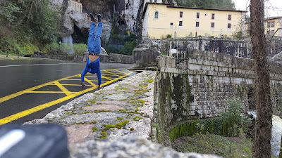This pic has it all: handstands, waterfalls, sacred caves, churches, nature, and more!