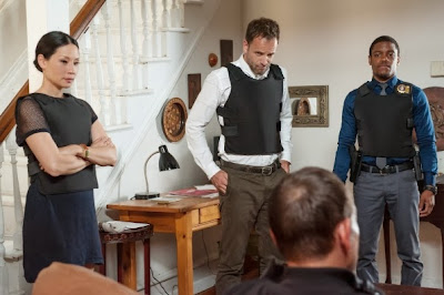 Jonny Lee Miller, Lucy Liu and Jon Michael Hill as Sherlock Holmes, Joan Watson and Detective Marcus Bell question a suspect in CBS Elementary Season 2 Episode 5 Ancient History