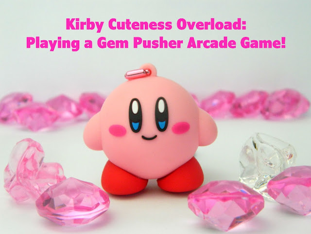 A photo of a Nintendo Kirby keychain and some shiny plastic gems