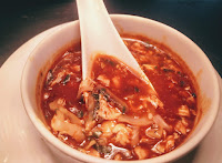 Serving chicken hot and sour soup