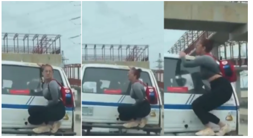 White Woman seen as she climbed the Back Of A Moving Bus In Lagos (Video)