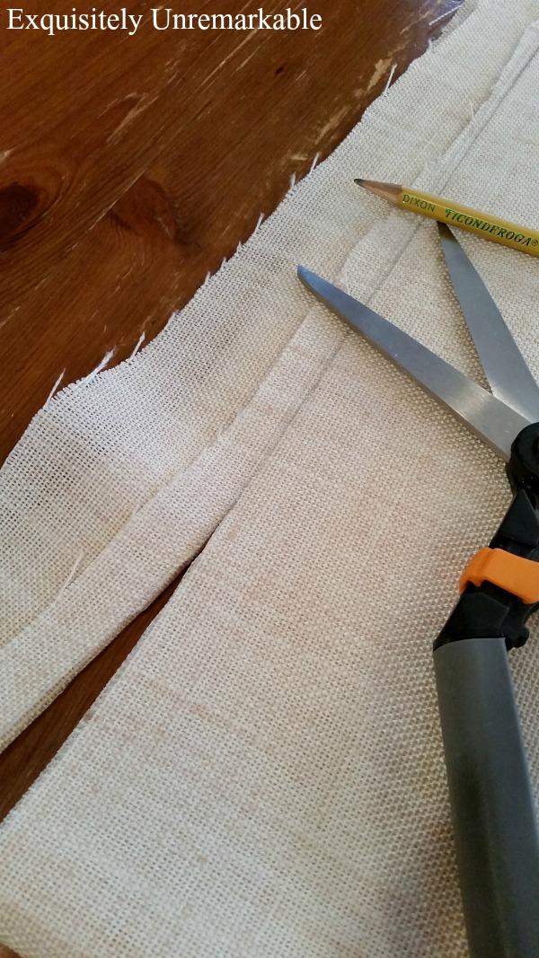 Cutting linen fabric with fabric scissors