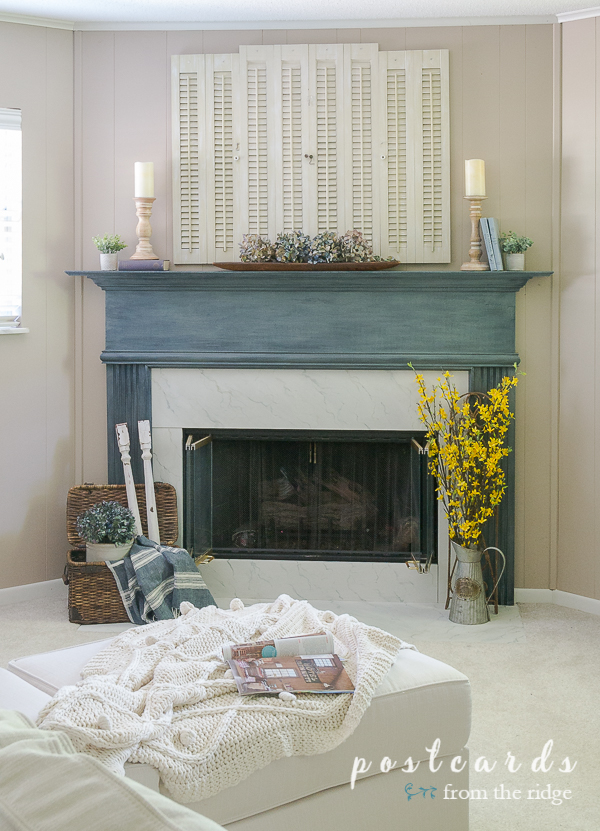 blue painted fireplace mantel and cozy decor