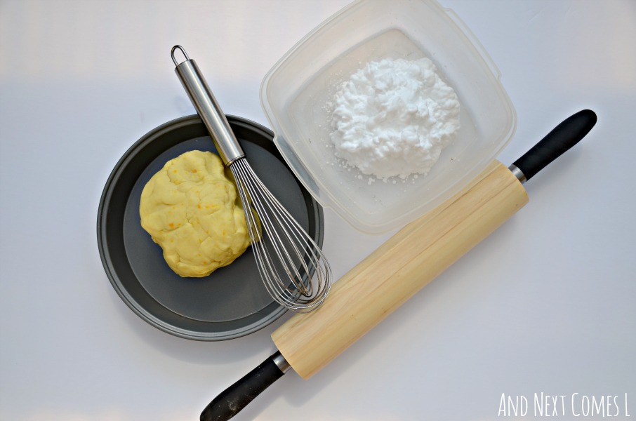 Fine motor pretend play prompt for toddlers and preschoolers using lemon scented play dough and shaving cream from And Next Comes L