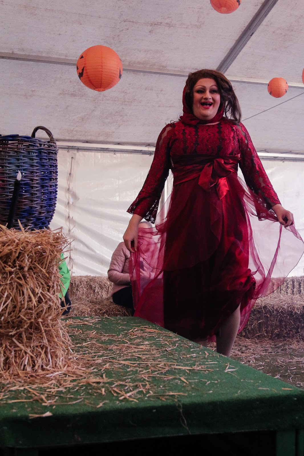 Long shot of one of the three witches at the M&D's pumpkin festival -  drag queen dressed up as a hocus pocus witch.