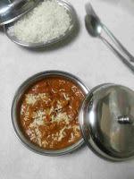 Serving Chicken lababdar with steam rice