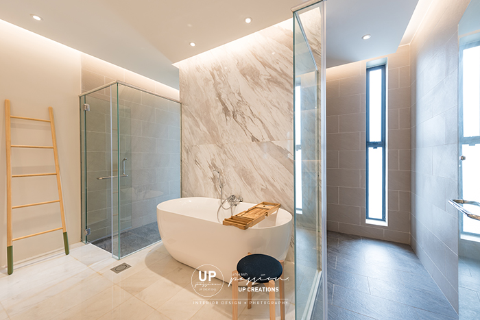 ss1 bungalow master bathroom in separated individual water closet area and shower area, middle in marble highlight wall with bathtub