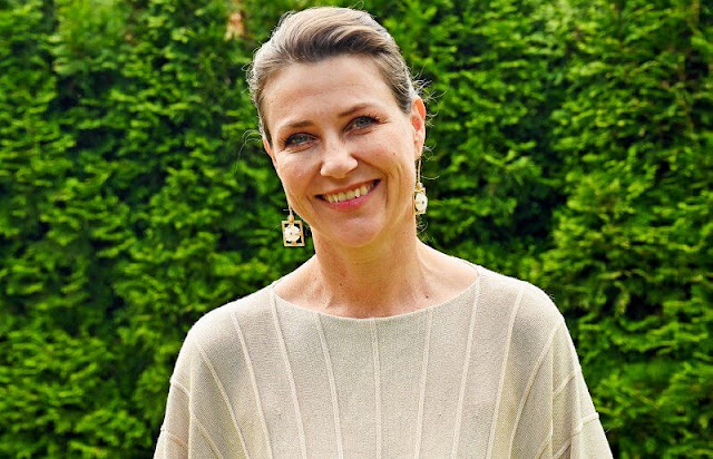 Norway Muscular Dystrophy Association. Princess Martha Louise wore a beige natural sweater and gold floral earrings