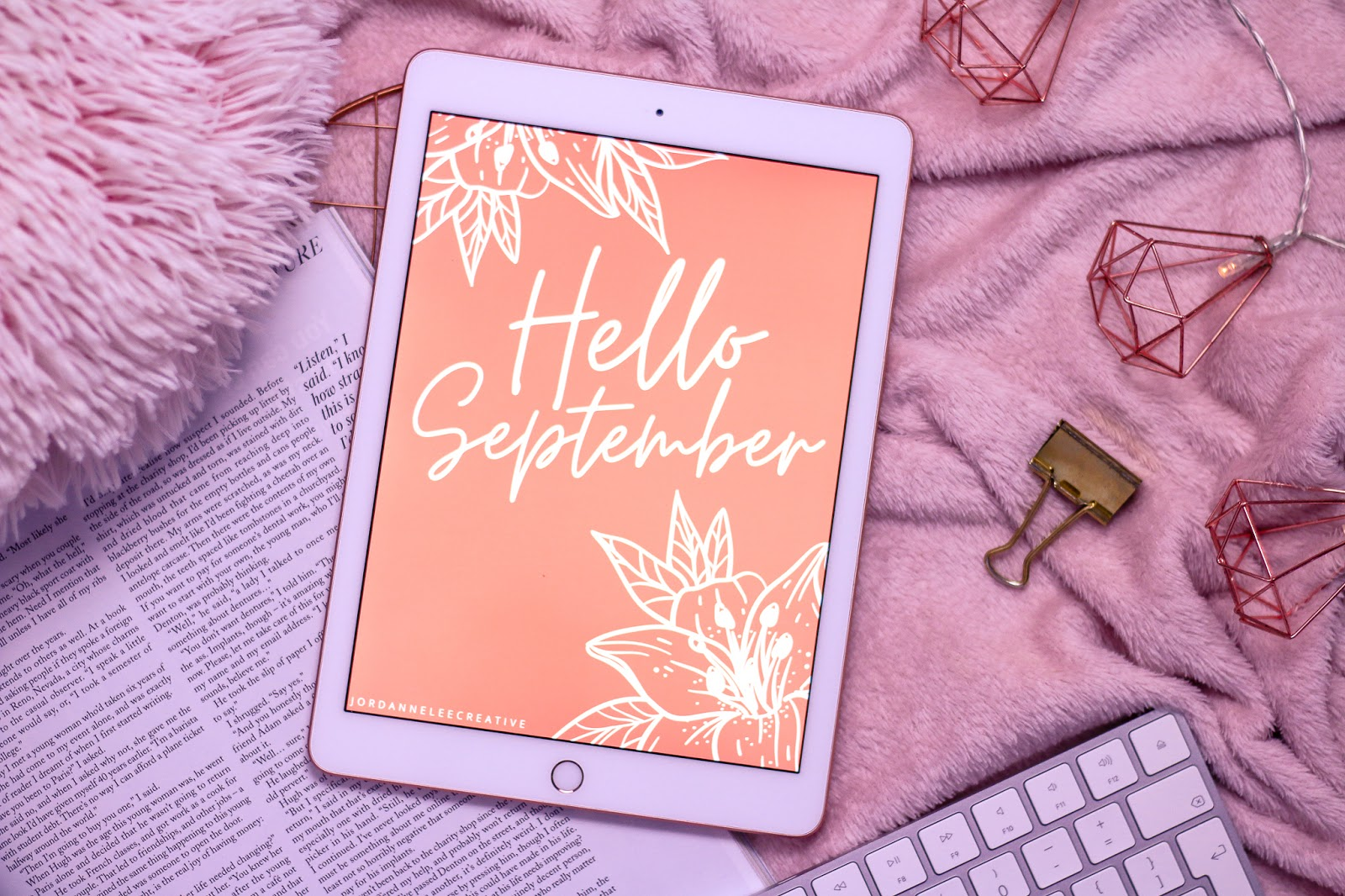 Birds eye view of an iPad with a Hello September graphic made by Jordanneleecreative on the screen