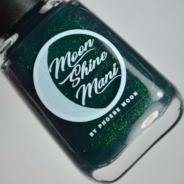 emerald green nail polish in a bottle