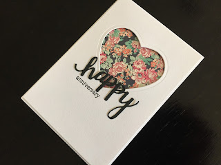 Hand made anniversary card with die cut aperture and greeting