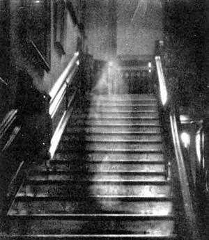 Black and White Picture of a Ghost Going up some Dark Stairs