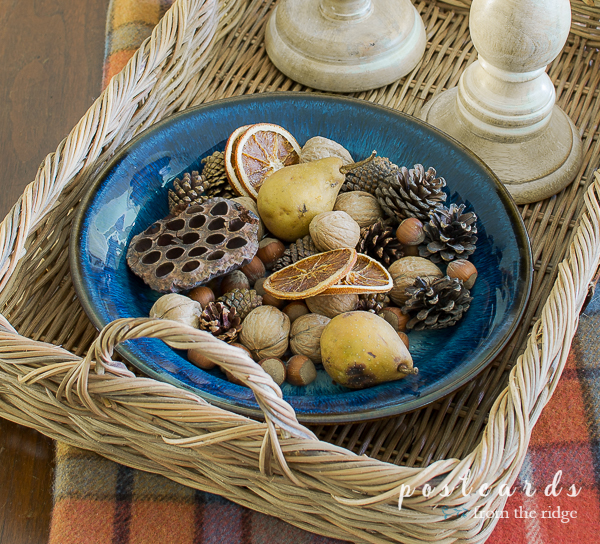 blue pottery bowl full of natural fall decor