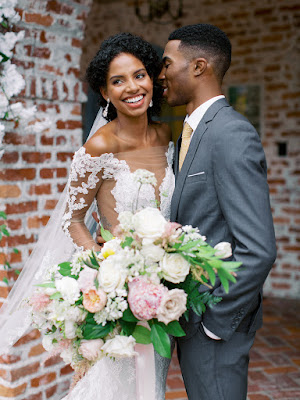 bride smiling with groom and bouquet