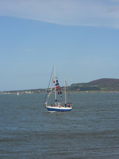Small sailboat viewed from Great South Wall in Dublin