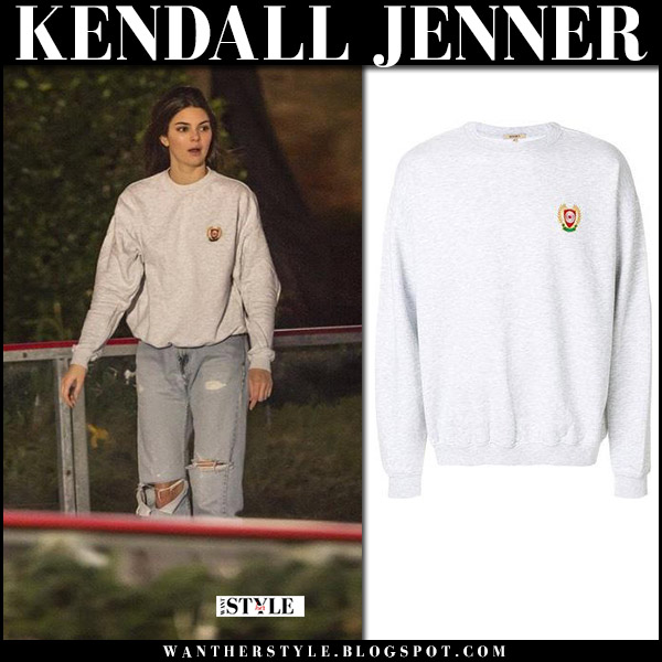 Kendall Jenner in grey sweatshirt yeezy and jeans ice skating street style december 8