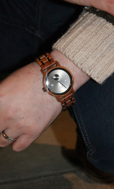 wooden watch on a mans wrist