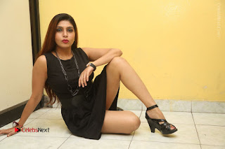 Tollywood Upcoming Actress Pooja Roshan Stills in Black Short Dress at Plus 1 Movie Trailer Launch  0381.JPG