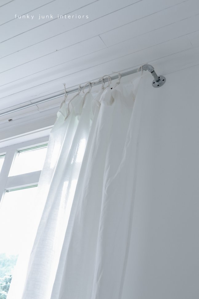 How to make pipe curtain rods with sheet curtains. Plus learn how to use a pipe cutter with video!