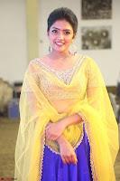 Actress Eesha in Yellow Choli Blue Ghagra at Darshakudu music launch 038.JPG