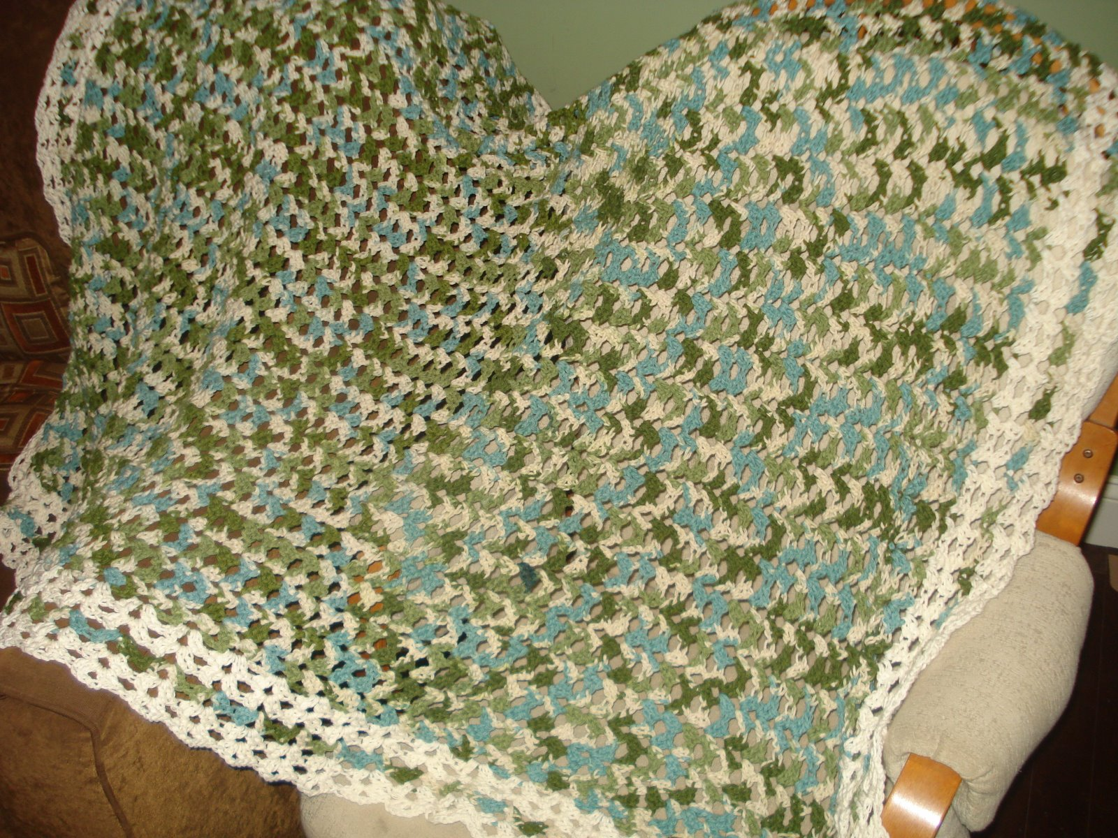 A Ginger Mess Crocheted Blanket With Variegated Yarn
