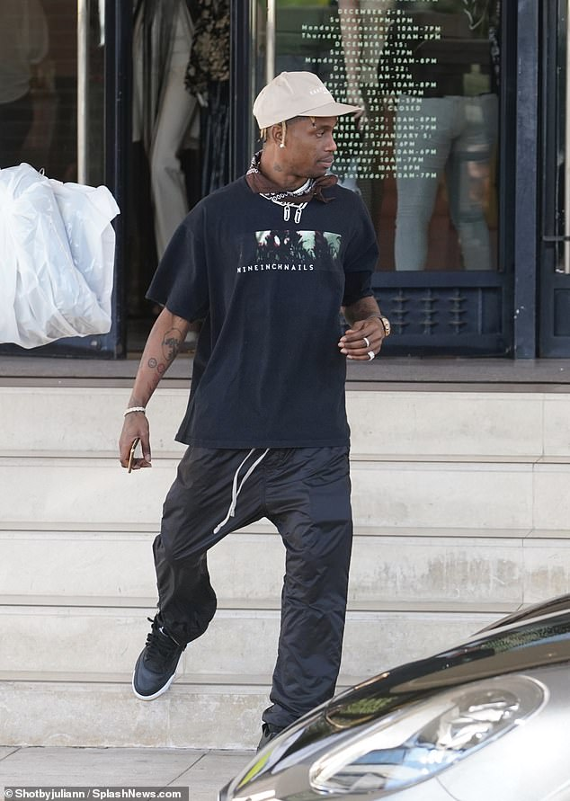 167141eee7430 Travis Scott does some shopping at Gucci before leaving in a Lamborghini to  his sold-out AstroWorld show