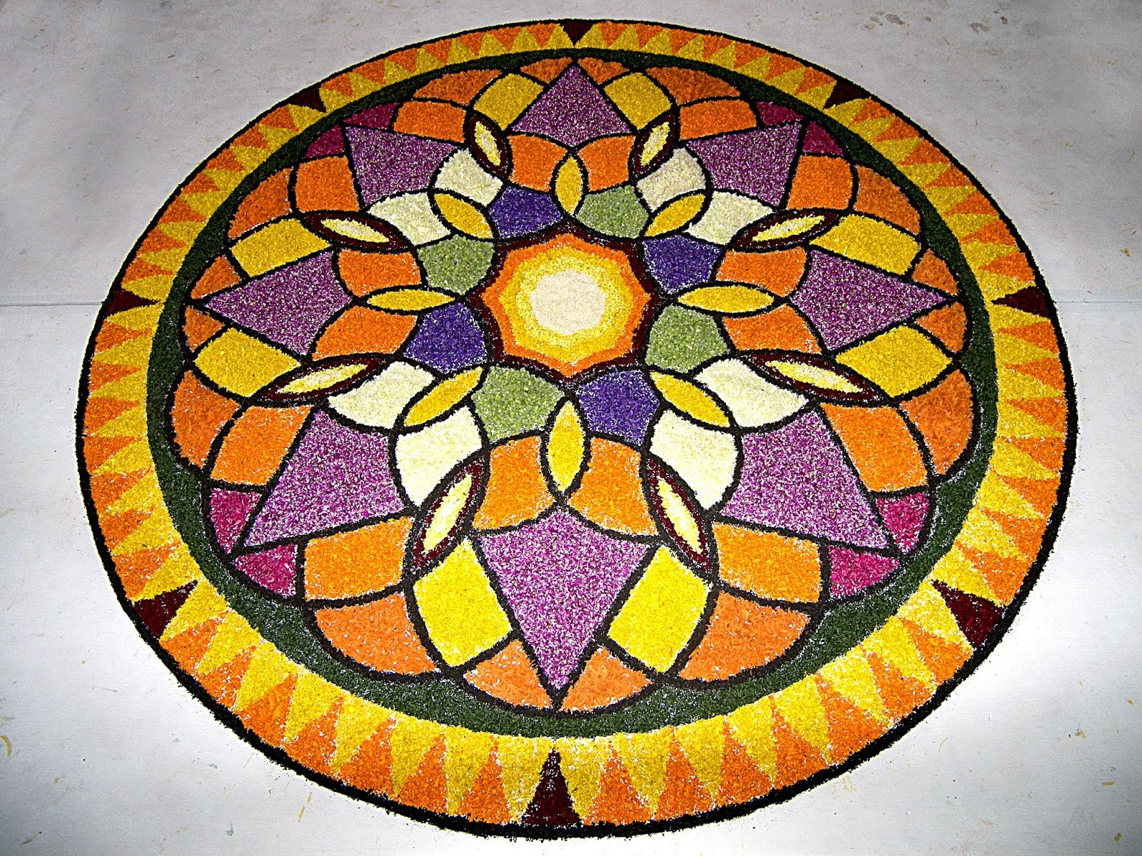 Onam 2015 pookalam and floral design concept