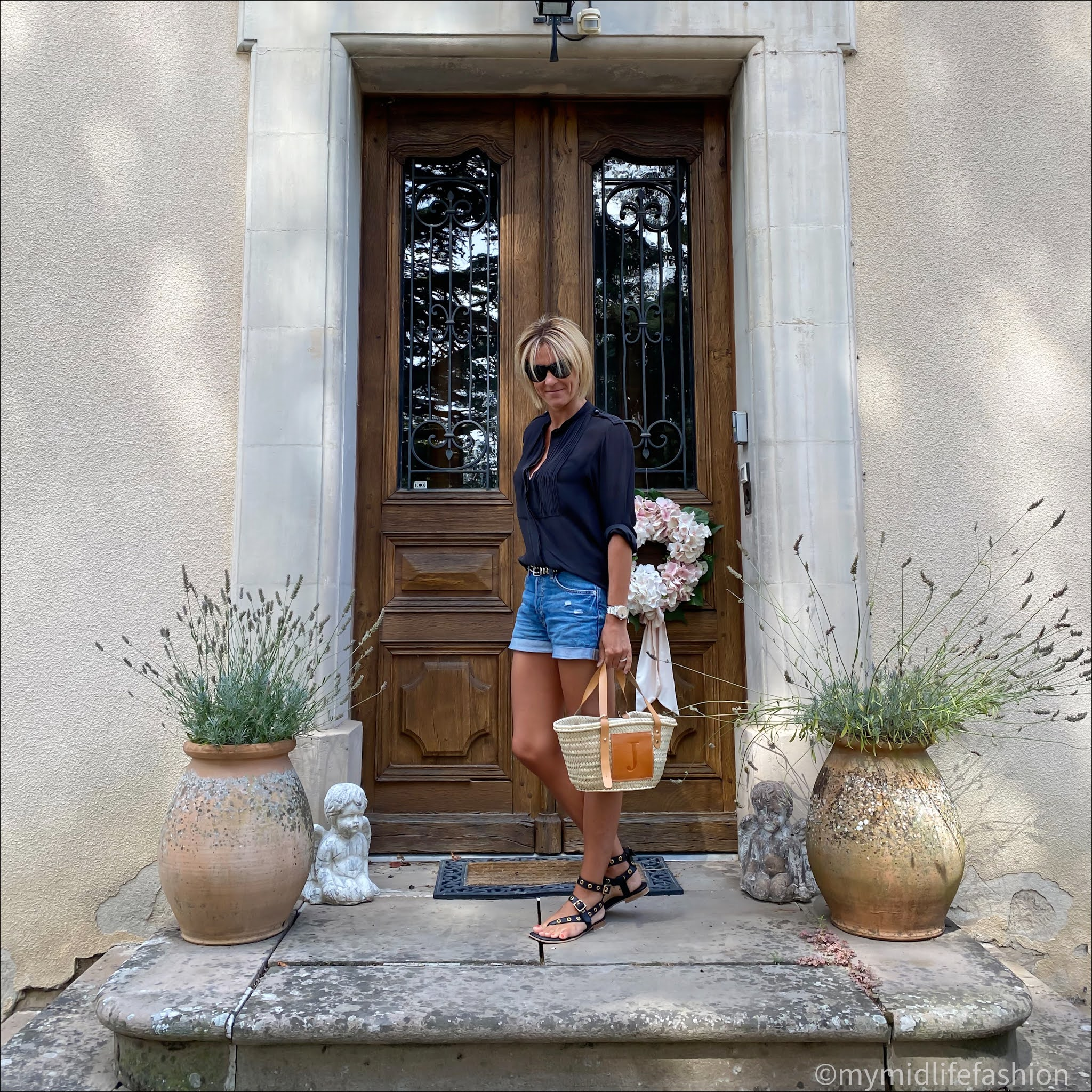 my midlife fashion, h and m denim shorts, Isabel Marant Etoile silk blouse, iro Paris leather eyelet sandals, monogrammed straw tote