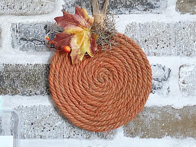 jute pumpkin on brick background