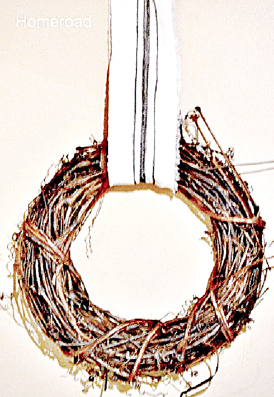 wreath hanging from diy grain sack ribbon
