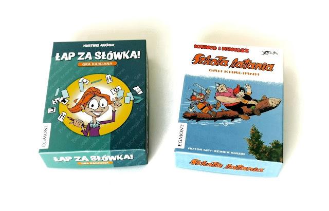 na zdjęciu dwie małe gry karciane łap za słówka i Kajko i kokosz szkoła latania