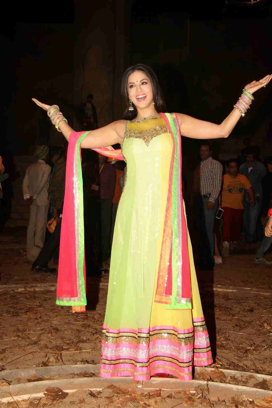 Model Actress Sunny Leone Stills In Yellow Dress