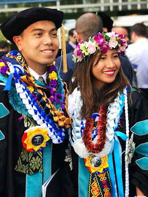 Filipino graduates from USA wearing Philippine-flag rosette lei during their graduation