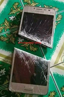 Jealous Husband Slices Wife's Phone For Not Telling Him Her Password.