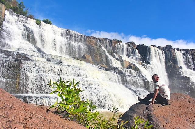 Marky Ramone Go sits atop a rock near Pongour in Da Lat, Vietnam