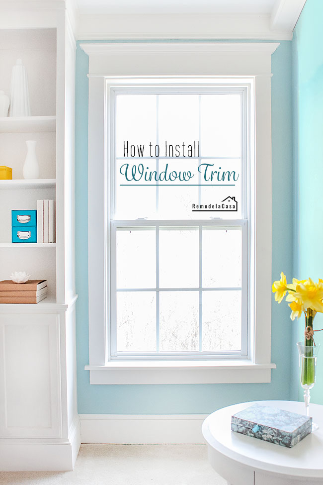 install classical window trim with crown molding in two windows in bedroom - teal walls