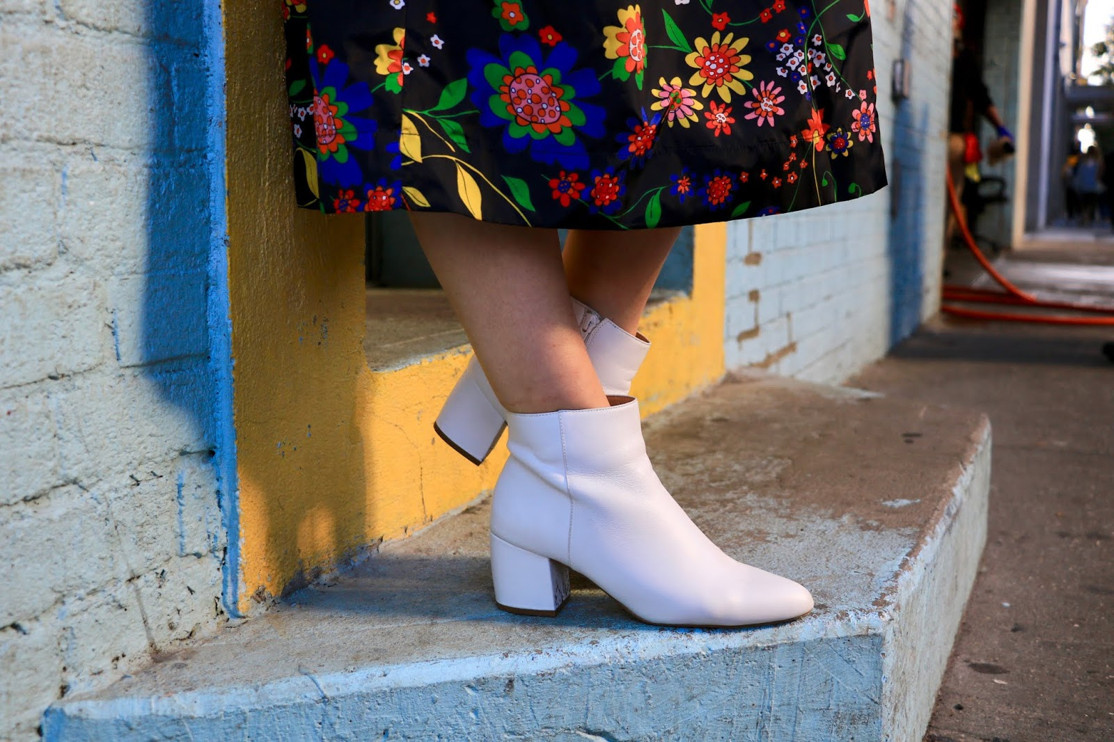 Nyc fashion blogger Kathleen Harper wearing white Nic and Zoe booties.