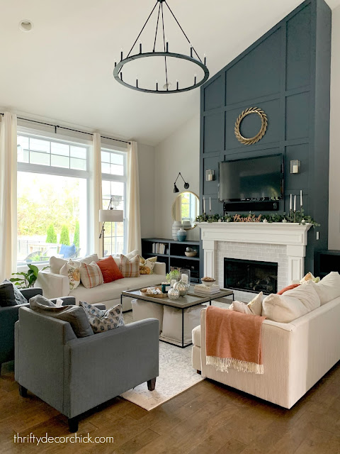 Two story family room with navy fireplace