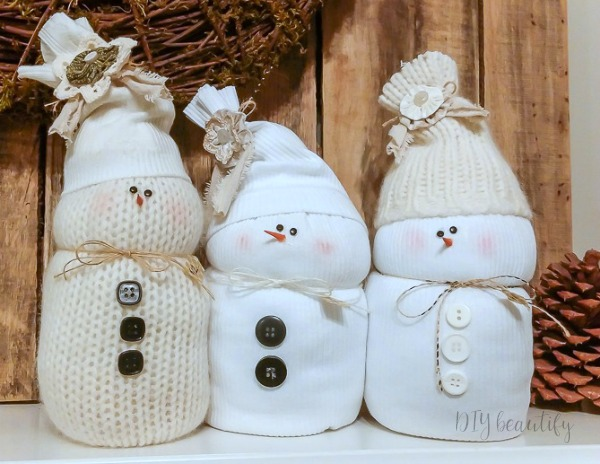 neutral snowmen made from discarded sweaters and socks