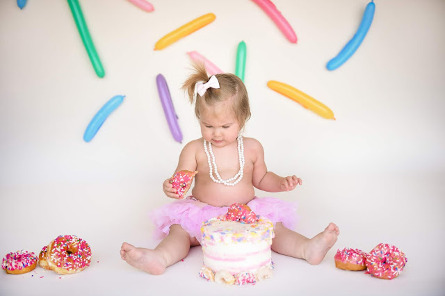Beige backdrop with sprinkles and donuts