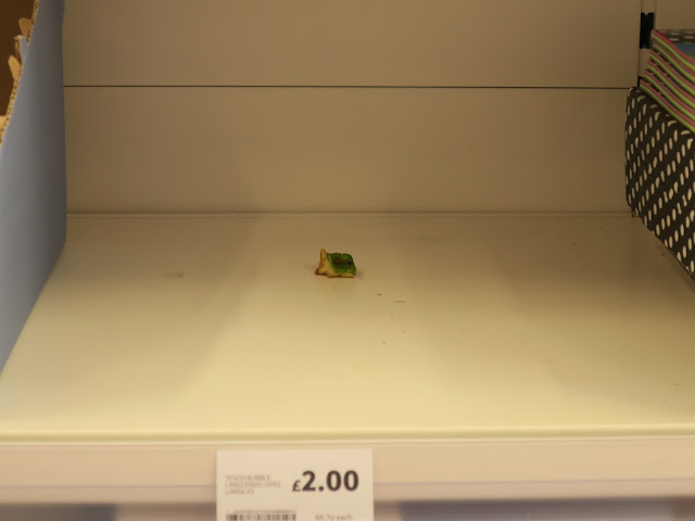 Stalk an top piece of apple on stationery shelf at Tesco, Portland, UK