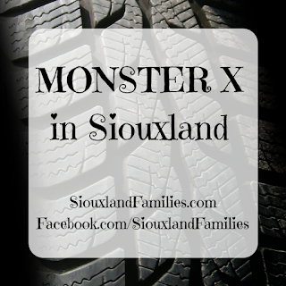 "in background, the black treads of a large tire. in foreground, the words ""MONSTER X in Siouxland"" and ""SiouxlandFamilies.com Facebook.com/SiouxlandFamilies"""