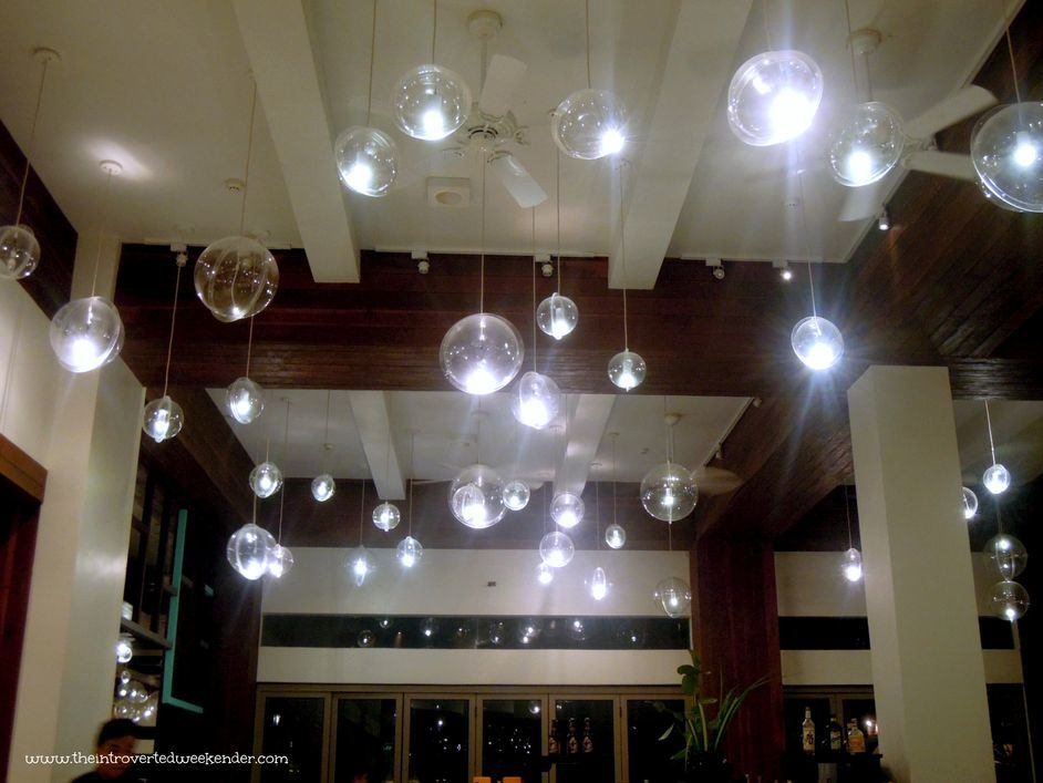 Orb lights hanging from the ceiling of The Beach House at Costa Pacifica