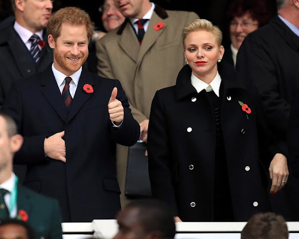 Prince Harry and Princess Charlene watched the rugby match, Princess Charlene style wore coat