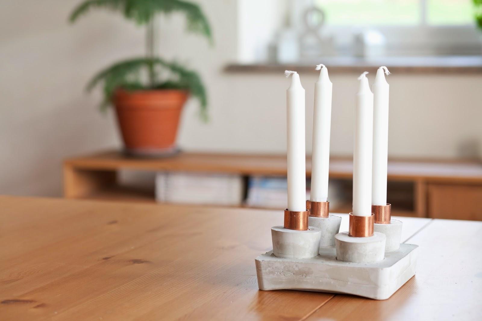 Diy weihnachten: ein adventkranz aus beton mit kupfer muffen oder